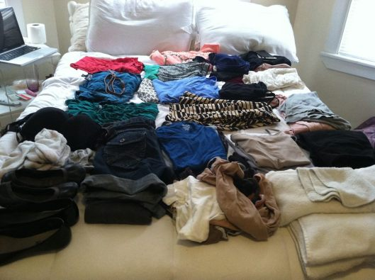 Included here are three skirts, roughly 8 t shirts, one pair of jeans, one pair of shorts, four dresses, four tank tops, two cardigans, yoga pants, plenty of underwear and socks, a bath towel, hand towel and washcloth, two bathing suits, one bra, four belts and two pairs of flats. One trick I've found to getting everything in the suitcase is wearing whatever bulky items you might want to take with you on the plane a la body suitcase. Which is why I'll travel in my other pair of jeans, light sweatshirt, and sneakers.