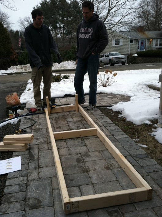 Now they start on the box. We notice after making the initial frame that something is a little wonky with the 2x4s. There is much pow-wowing about how to proceed. I am frantic at this point.